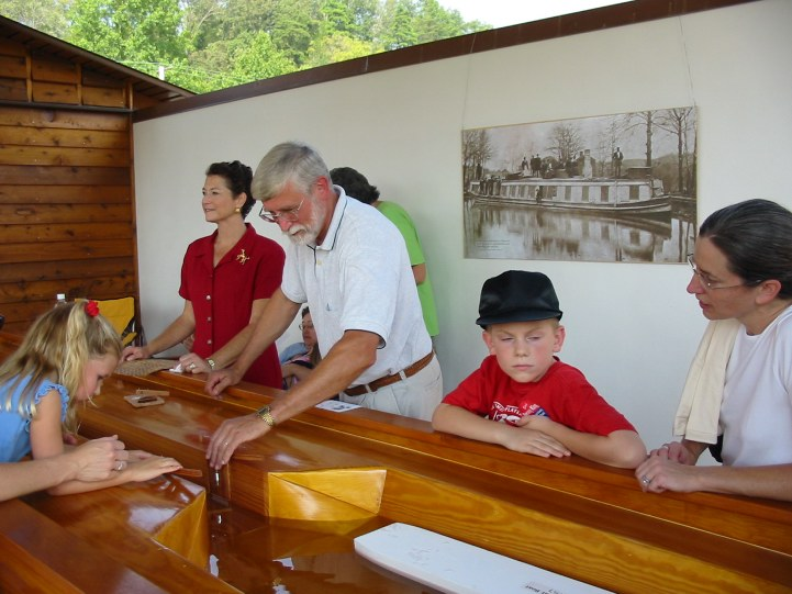 Tim Small demonstrating the scale model James River and Kanawha canal lock